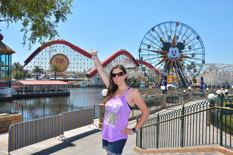 Woman posing in front of Pixar Pier at Disneyland California Adventure