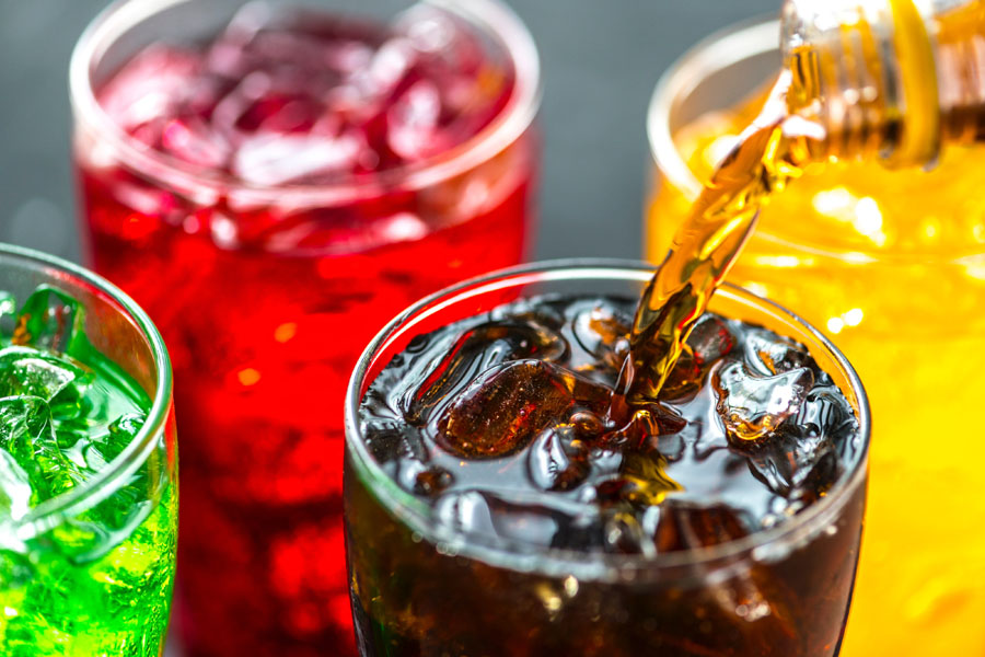 Brightly colored carbonated beverages in glasses