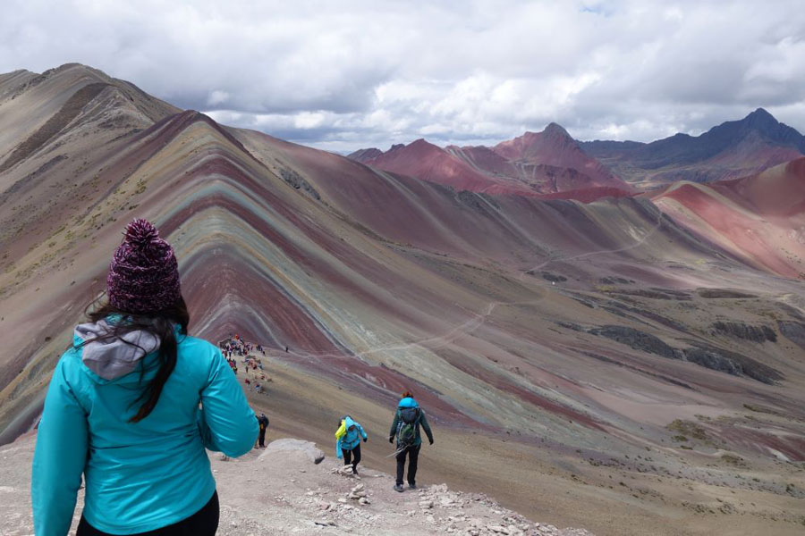 Hiker in front of the Rainbow Mountain in Peru