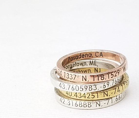 Stack of rings with GPS coordinates engraved