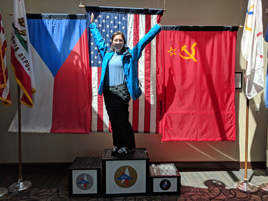 Woman standing on fake Olympic podium at Squaw Valley