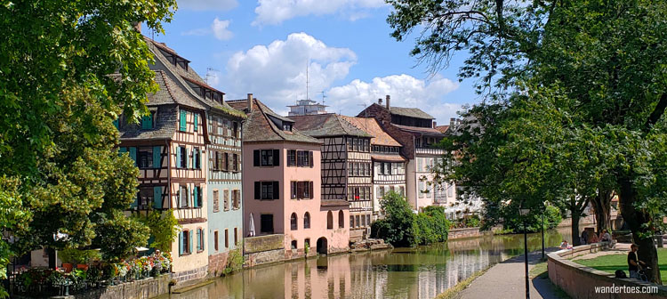 Colorful buildings along a river in Strasbourg, France