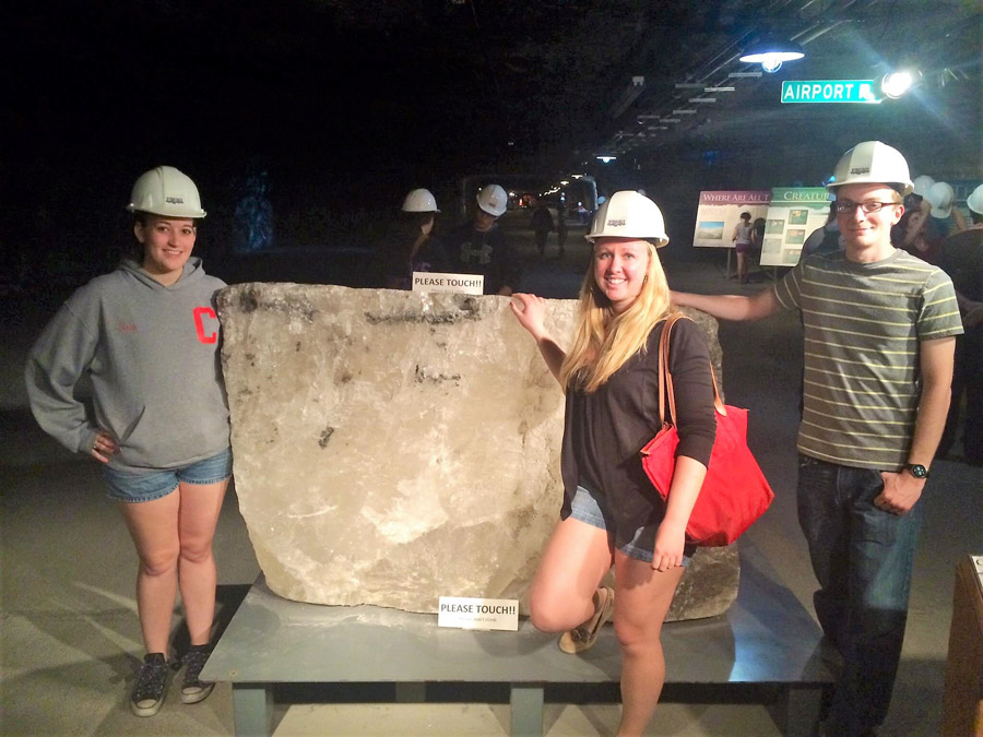 Visitors posing with a salt rock in the Strataca Salt Mine