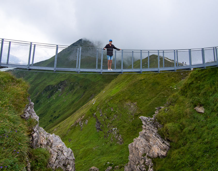 Visitor on a suspension bridge at the top of Stubnerkogel in Austria