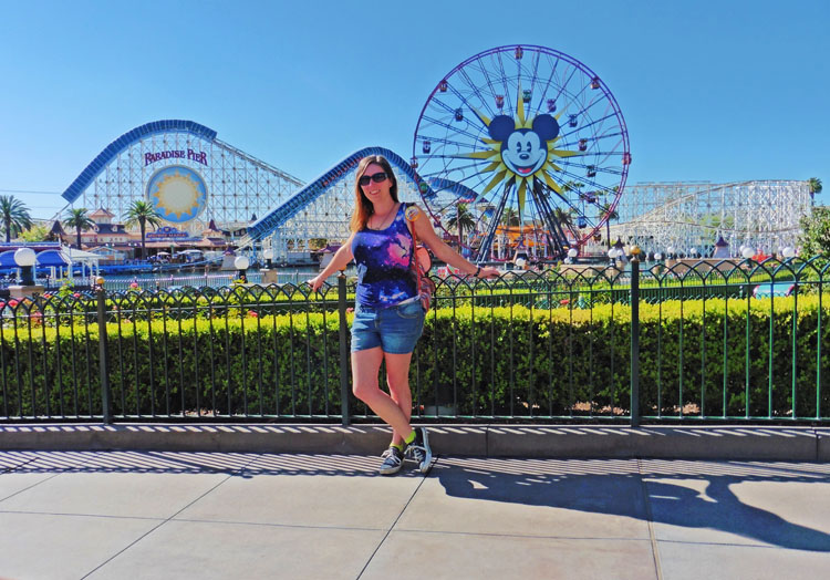 Woman posing in front of Paradise Pier at Disneyland California Adventure