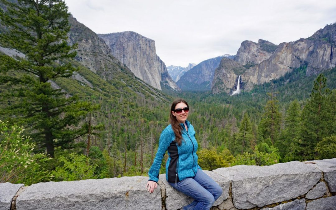 Woman posing at the entrance to Yosemite Valley