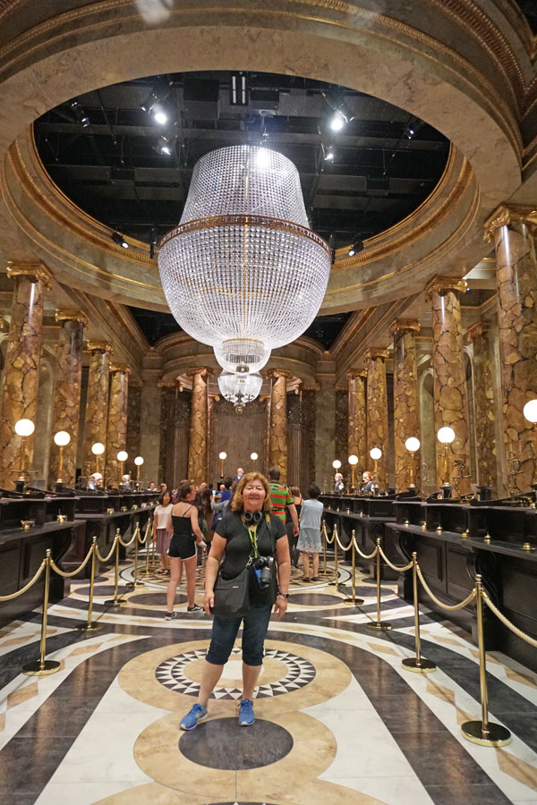 Woman posing in the Gringotts Bank lobby