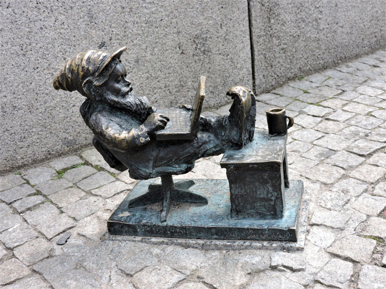 Statue of a dwarf using a laptop in Wroclaw, Poland