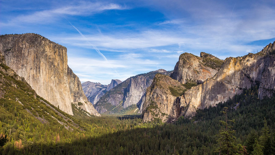 Granite cliffs of the Yosemite Valley under blue skies