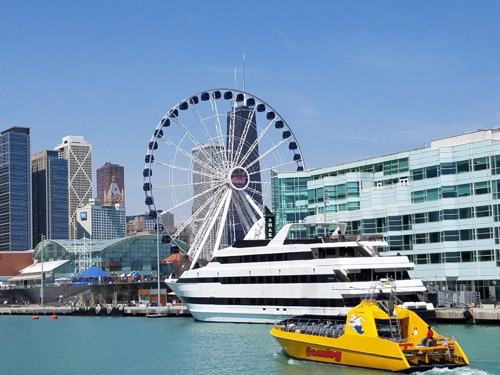 Navy Pier with boats in the foreground and a ferris wheel - Best of the Midwest