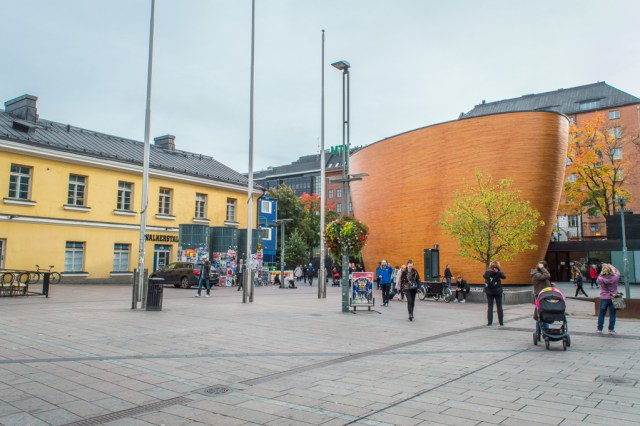 The Chapel of Silence stands out in the busy square at Kamppi in Helsinki.
