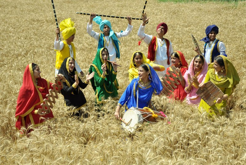 Student of Scholar fields school celebrate the Baisakhi festival in a fields at Patiala on Thursday photo by Ajay Verma 12-4-12