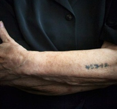 The 5-digit number tattooed on a woman's arm, a survivor of Auschwitz and the Nazi Holocaust.