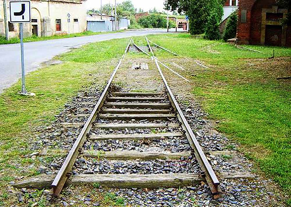 Train tracks lead away from the Terezín Ghetto and Concentration camp, heading east, toward Auschwitz-Birkenau.