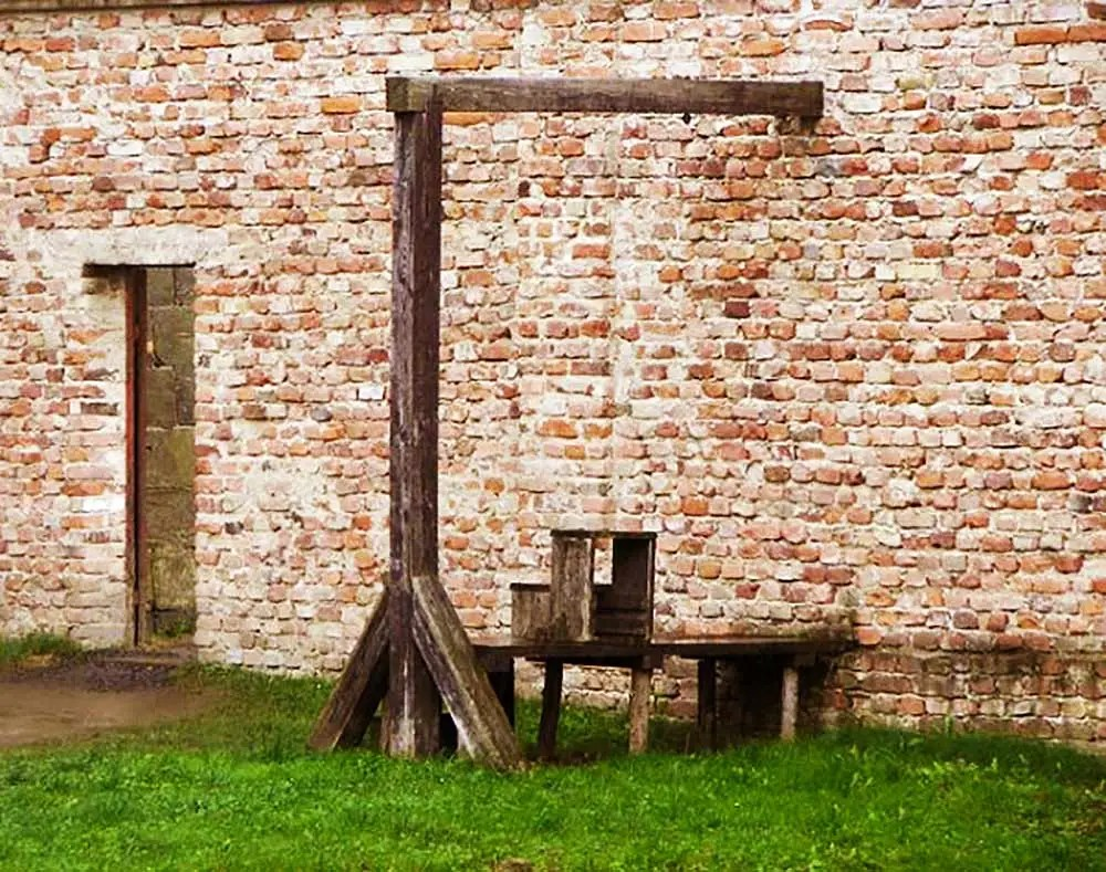 The wooden gallows at Terezín Prison Camp, with their rickety steps and rough wood platform, look like something a child would build.
