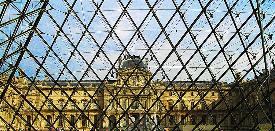 Louvre Museum seen from inside the courtyard glass pyramid