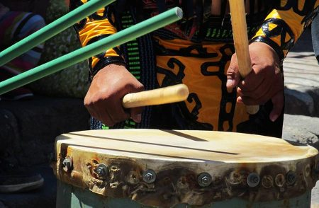 The wooden sticks pound the hide skins of the concheros drums