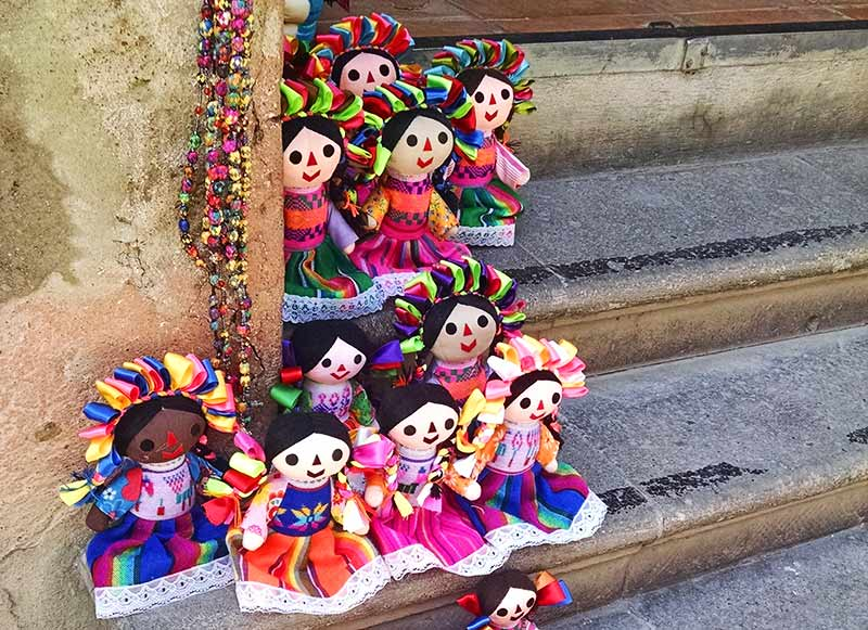 Mexican handicraft Otomi dolls for sale in a doorway in San Miguel de Allende, Mexico