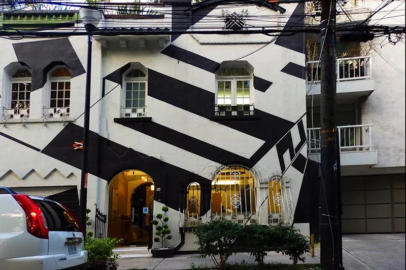 House painted in black-and-white geometric pattern on Avenida Amsterdam, La Condesa, Mexico City