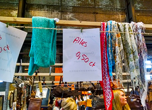 A rack of scarves on sale for half a Euro.