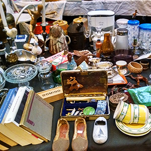 A mix of books, shoes, dishes and other merchandise