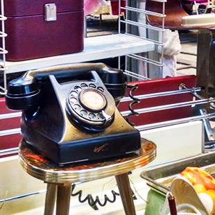 A vintage black rotary phone at IJ-Hallen