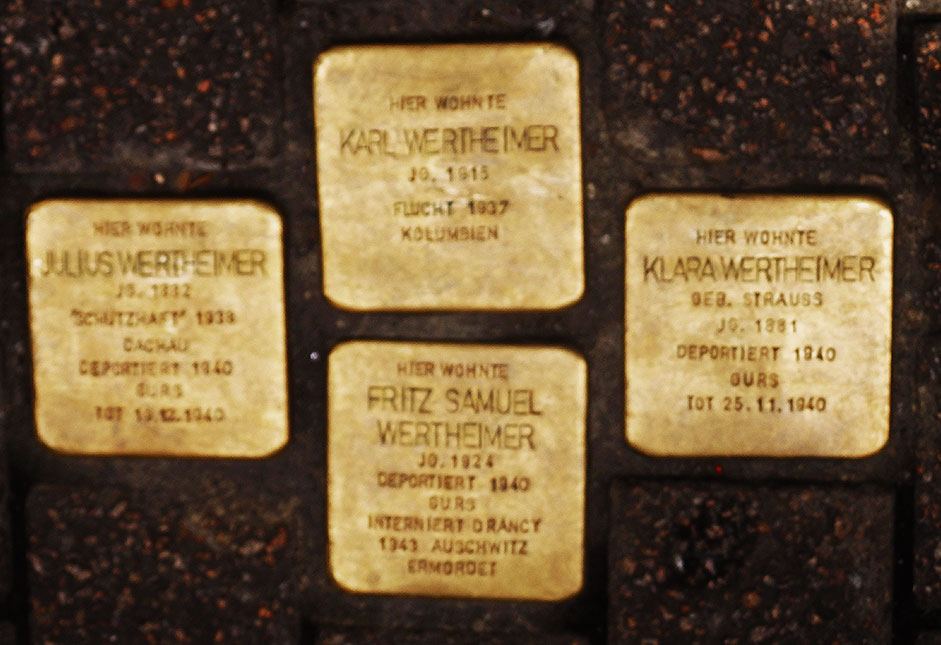 Four brass-topped stolpersteine are engraved with the names, birthdates and date and place of death of four members of the Wertheimer family in Heidelberg.