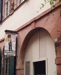 The entrance to the Heidelberg Studenten Karzer, marked by a sign with an incongruous cherub.
