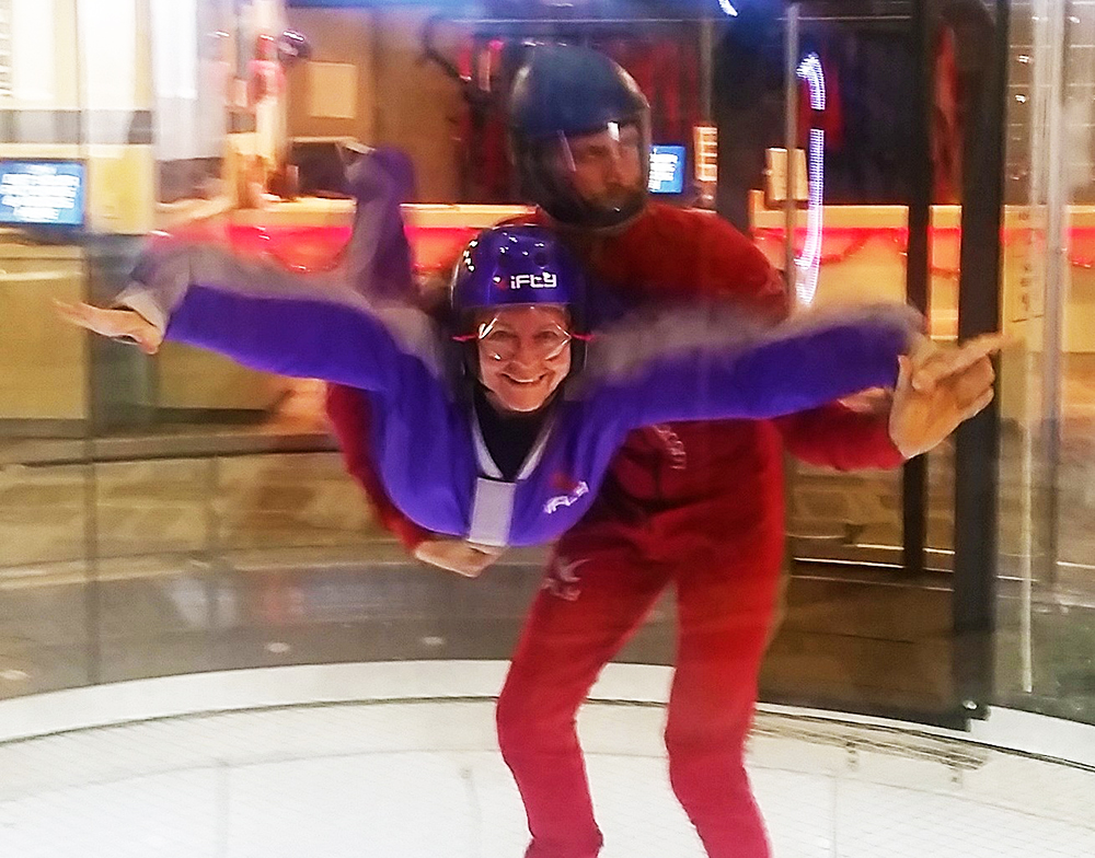 Me, flying and smiling for the camera, at iFly, Portland, indoor skydiving