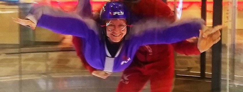 Me, flying and smiling for the camera, at iFly, Portland