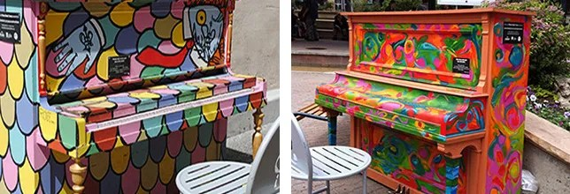 A pair of colorful artist-painted pianos on the streets of downtown Fort Collins, Colorado
