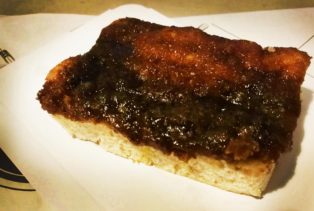 Danish Brunsviger with its think, gooey topping of caramelized brown sugar.