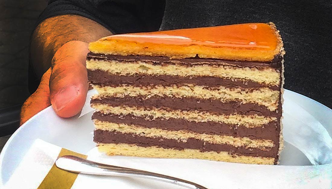This multi-layered slice of Dobos Torte shows the hardened caramel topping that seals it and keeps it fresh.