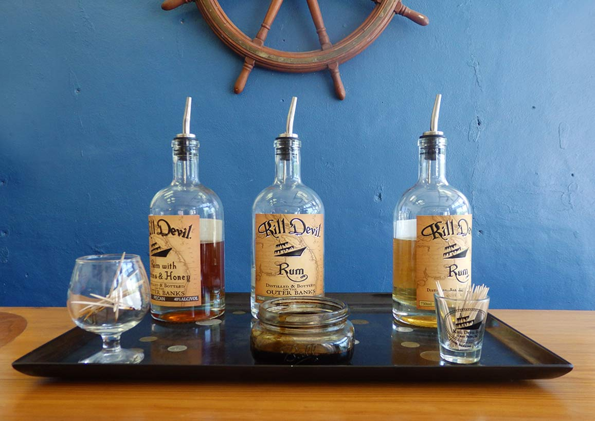 Three bottles of rum ready for tasting at Outer Banks Distilling, in Manteo, North Carolina