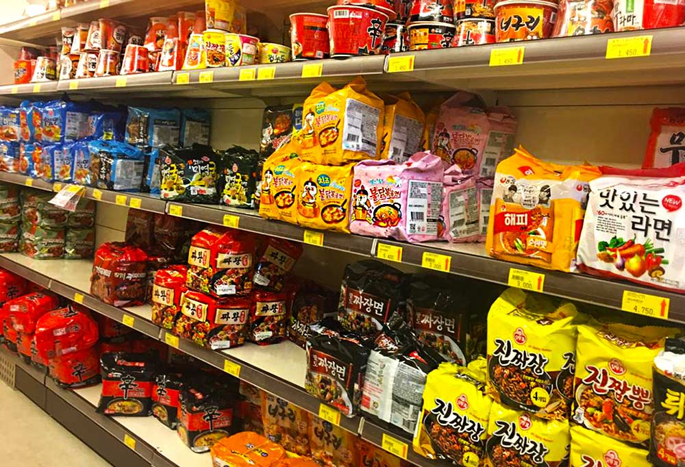 Supermarket shelves and shelves full of every kind of ramen in bags and cups, i Korea.