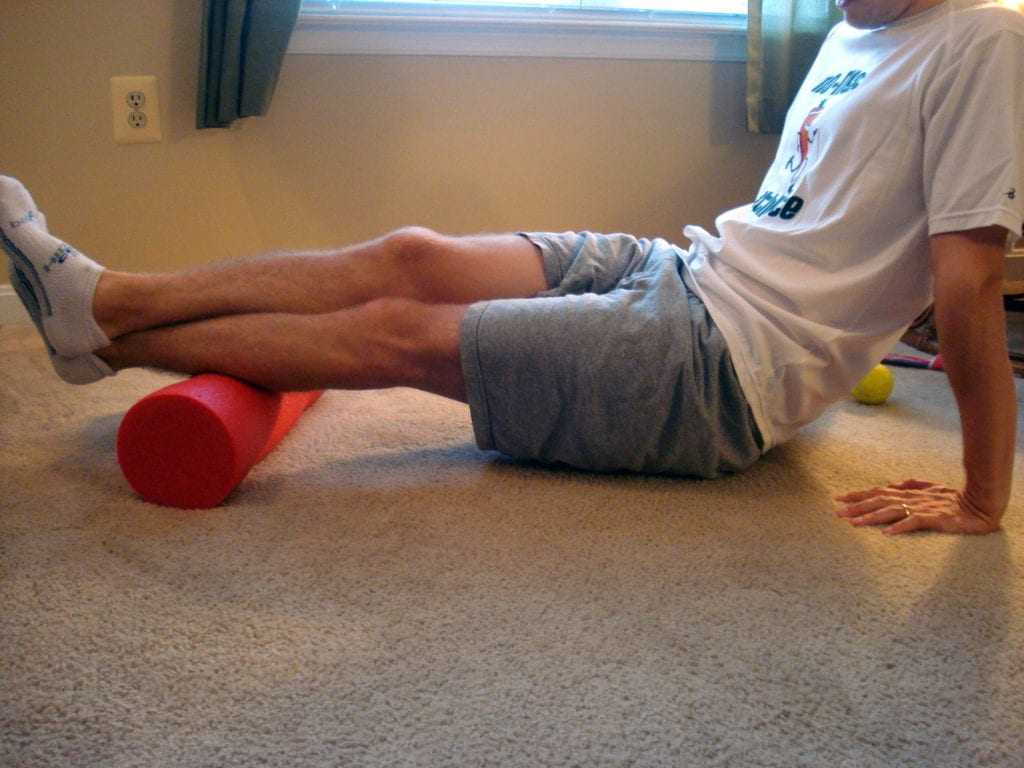 Using a foam roller for triathlon recovery stretching fitness