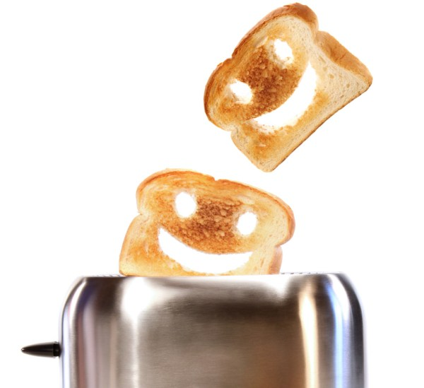 Toasted bread with toaster on white background