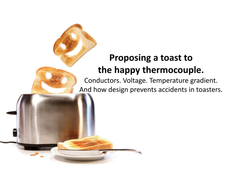 Two pieces of toast popping out of an old fashioned toaster