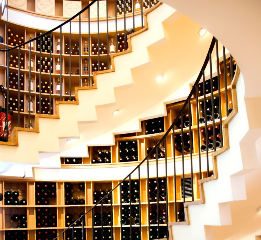 stairs and glass bottles in modern France wine shop
