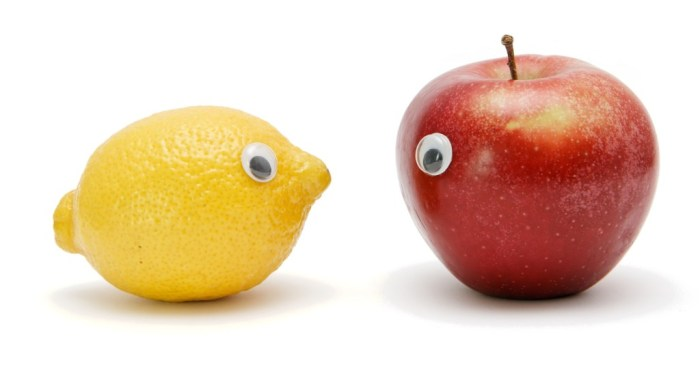 Funny lemon and apple with eyes isolated
