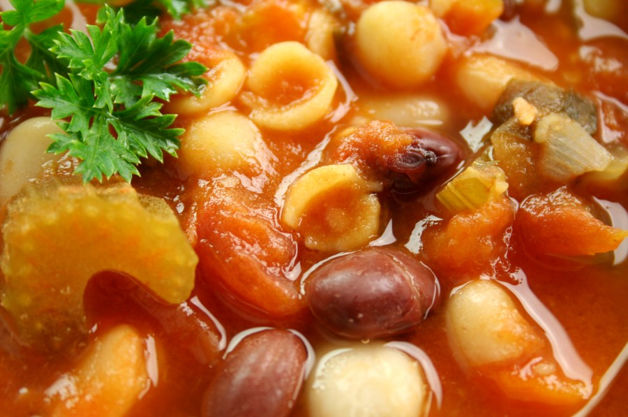 Close up of delicious freshly made Italian minestrone soup with parsley and beans
