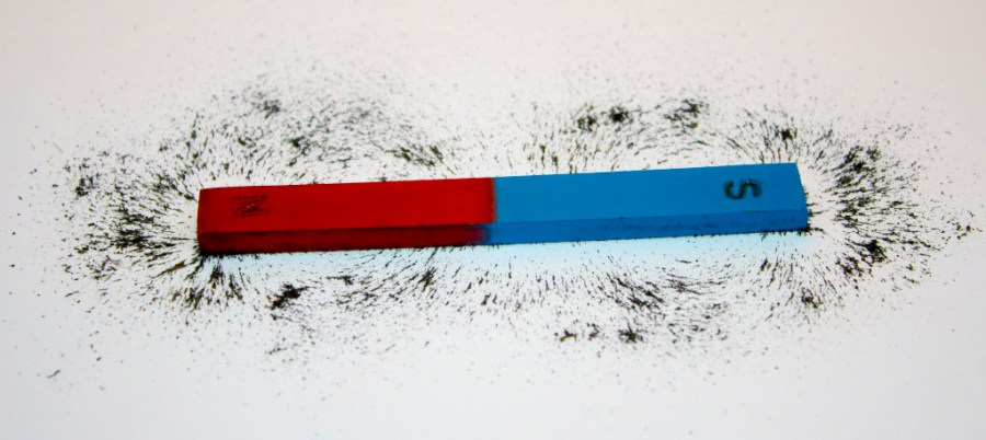 Ferromagnetism: Bar magnet. Iron filings show magnetic field lines.