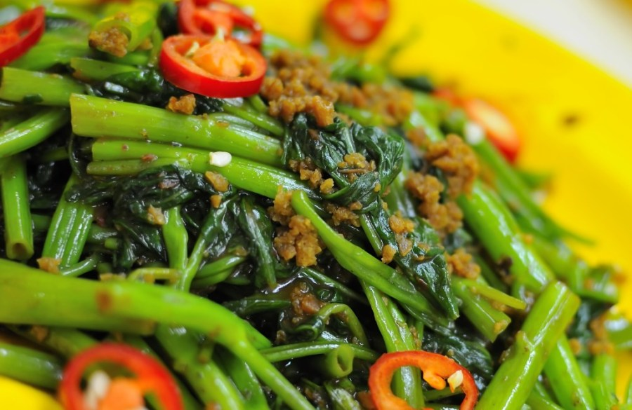 Chinese style kang kong vegetables cooked with spicy vegetarian sambal chili sauce.