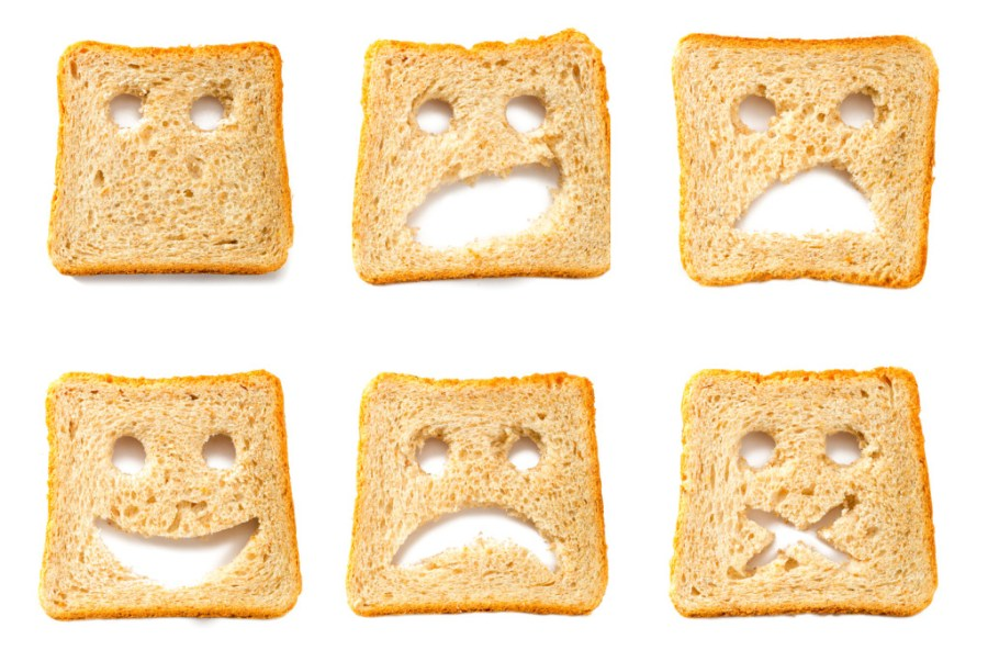 Toasted bread slices for breakfast with funny faces