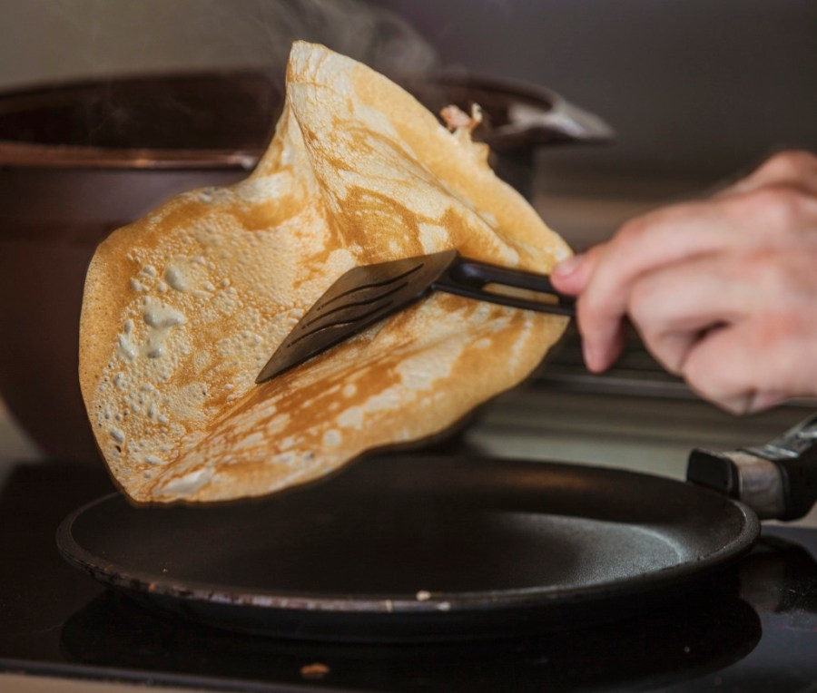 flipping pancakes with a spatula