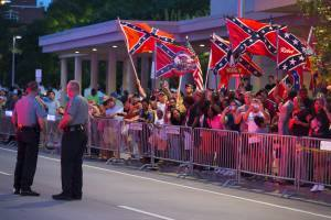 Confederate flag rally outside hotel where President Obama stayed in Oklahoma.