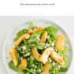 summer peach arugula with elderflower vinaigrette and crumbled feta cheese
