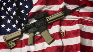 Assault rifle on American flag