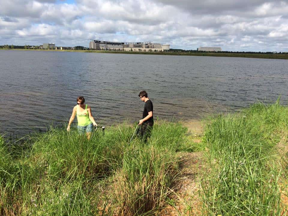 Neighbors going beyond the bushes to clean the water's edge