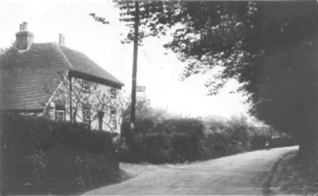 The old Post Office in The Drove, lower Holt Street. The PO sign can be seen on the telegraph pole